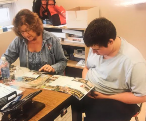 Shearer works with one of her students. Photograph Courtesy of Shearer