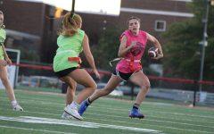Senior Shelby Derkosh makes her touchdown-scoring run past junior Maggie Grim. Photograph by Alexa Viands