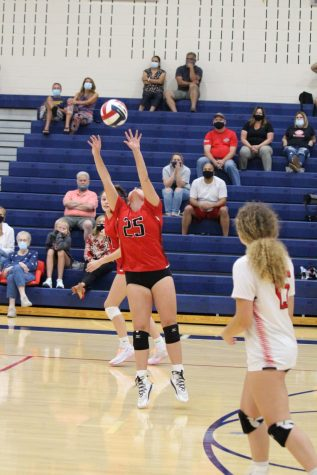 Freshman Claire Somerville sets the ball to get a point for the lady Warriors. Photograph by Tricia Rawleigh