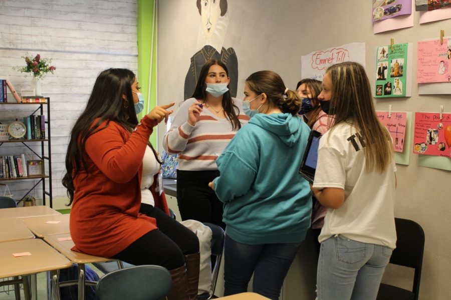 Muskant Singh works with students on an interactive lesson plan that moves groups around the room. Photograph by Grace Hartenstein