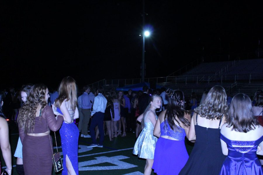 Susquehannock students gather around on the football field during the homecoming dance on Oct. 2. Photograph by Vicky Chen.